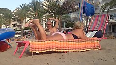 Granny's candid feet and soles rubbing at the beach - part. 2