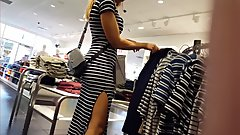 Candid voyeur MILF in striped tight dress shopping