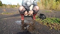 pissing outdoors mature brunette