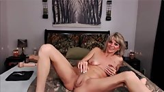 Erotic blonde mom fucks her tight pussy with a huge toy