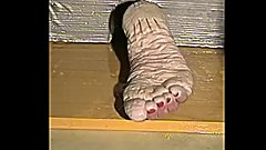 Bianca's wet feet torture Sawing in her pruney feet