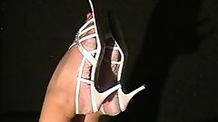 Bianca's wet feet in white heels and taking them off without her hands