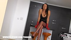 Busty Milf Nylon Jane with her long legs wrapped in fully fashioned nylons