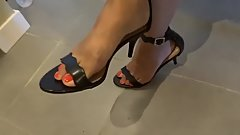 Friend Toe tapping in kitchen, kitten heeled sandals with red toes )