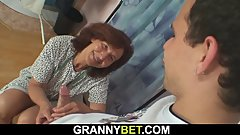 Sewing granny swallows customer's cock