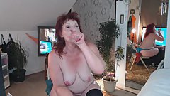 V90 redhead milf in a smoking, reading erotica and masturbating