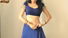 INDIAN SEXY WOMEN WEARING SAREE EXPOSING NAVEL