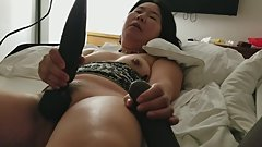 Asian milf plays with new toy